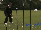 Bouncing Golf Ball Is Hit Off Concrete