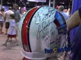 Fan Collects Autographs From Football Legends